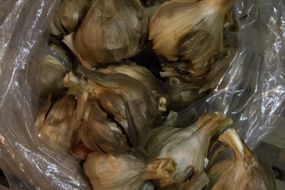 Unpeeled black garlic