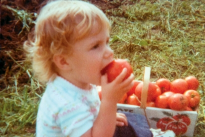 baby eating tomatoes