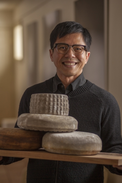 Cheesemaker Riko Chandra holds natural rind cheeses at Reverie Creamery.